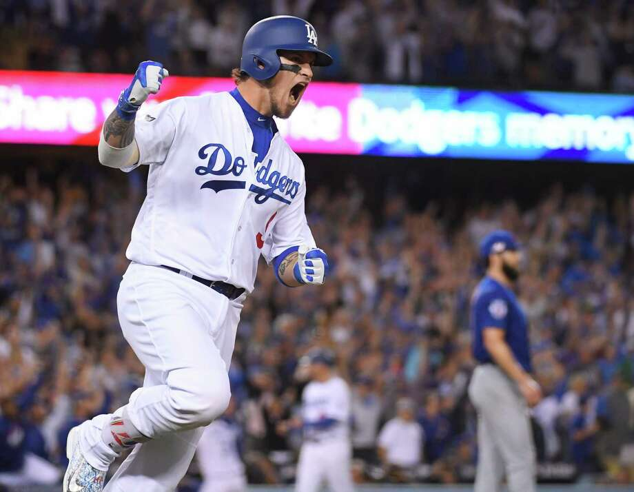 Los Angeles Dodgers' Yasmani Grandal hits a two-run home run during the fourth inning of Game 3 of the National League baseball championship series against the Chicago Cubs Tuesday, Oct. 18, 2016, in Los Angeles. (AP Photo/Mark J. Terrill) ORG XMIT: NLCS172 Photo: Mark J. Terrill / Copyright 2016 The Associated Press. All rights reserved.