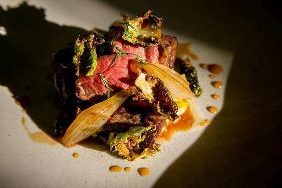 Beef, brussels sprout,s and fish sauce at Nightbird in San Francisco, Calif. is seen on October 18th, 2016.