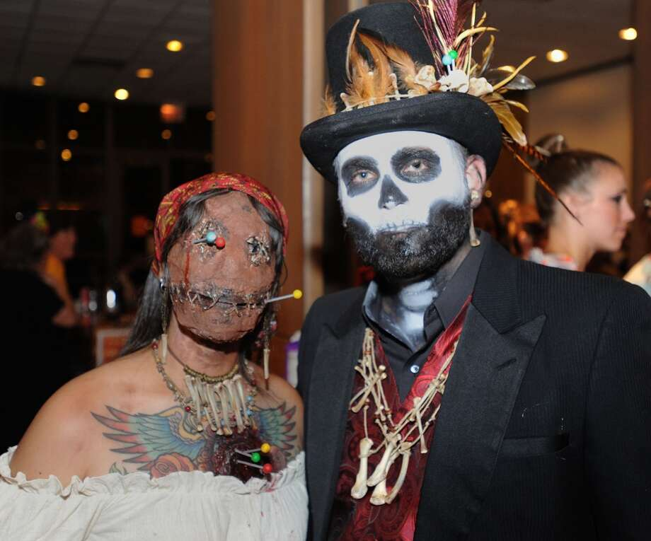 Michael and Melissa Degarmo at the Art Museum of Southeast Texas' Monster Mash fundraiser Friday night. Photo taken Friday, October 23, 2015 Guiseppe Barranco/The Enterprise Photo: Guiseppe Barranco/The Enterprise