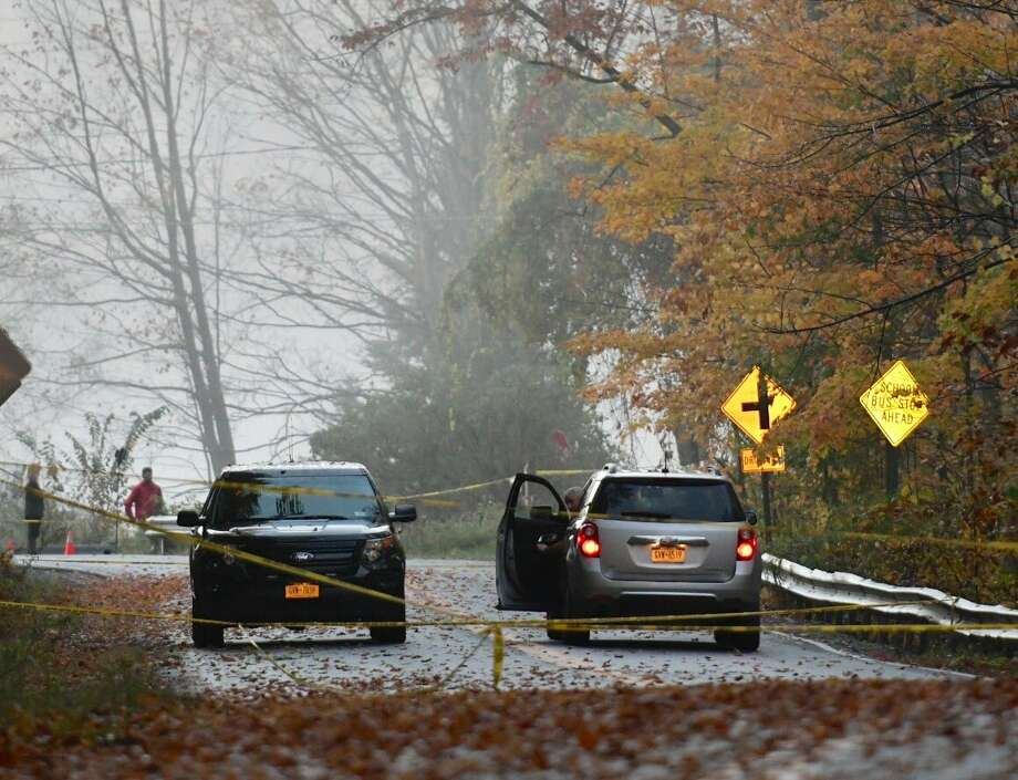 Blue Factory Hill Road in Brunswick, NY, is closed Wednesday, Oct. 19, 2016, after a body was found in the area. (Skip Dickstein/Timies Union)