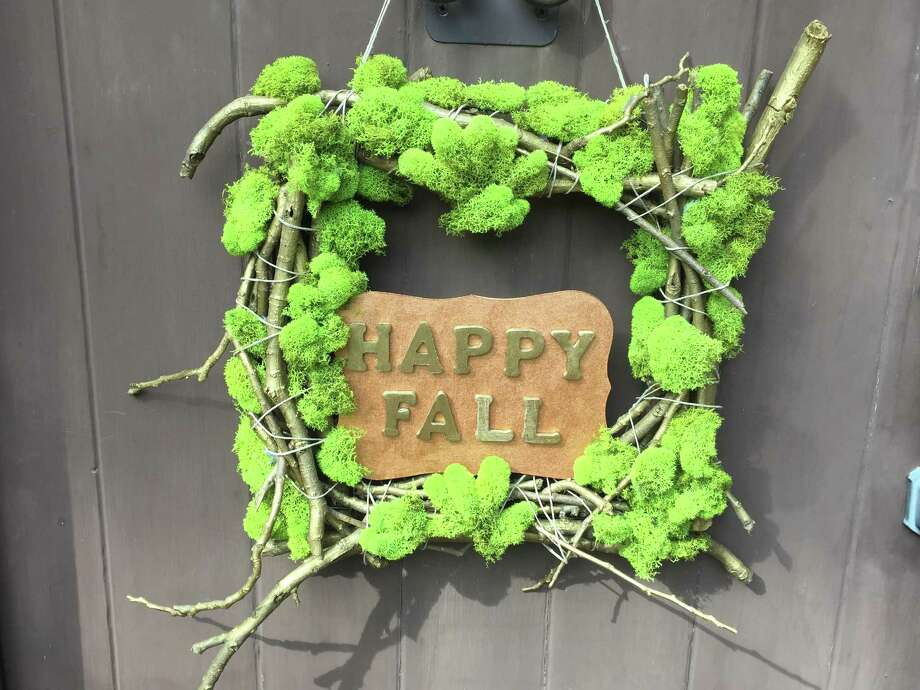 The moss and twigs wreath makes a fun alternative to a standard fall wreath. Use the sign in the middle for a fun fall message. Photo: Emily Spicer / San Antonio Express-News