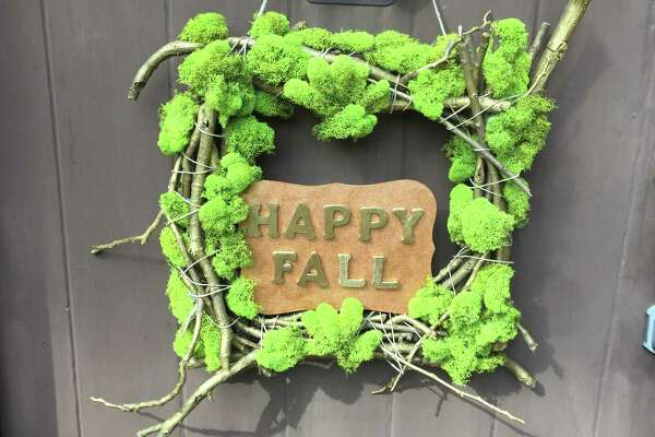 The moss and twigs wreath makes a fun alternative to a standard fall wreath. Use the sign in the middle for a fun fall message.