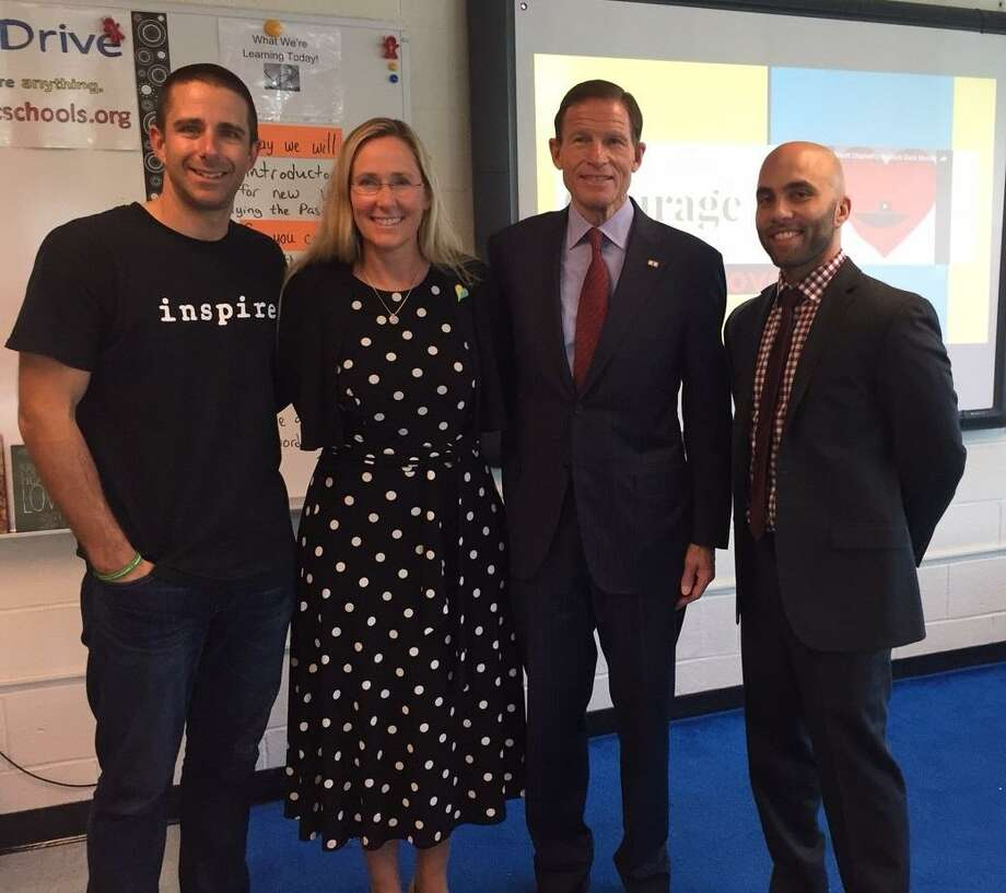 From left, teacher Jimmy Sapia; Scarlett Lewis, president of the Jesse Lewis Choose Love Movement; U.S. Sen. Richard Blumenthal and Principal Jason Martin at Rippowam Middle School Tuesday morning. Photo: Contributed