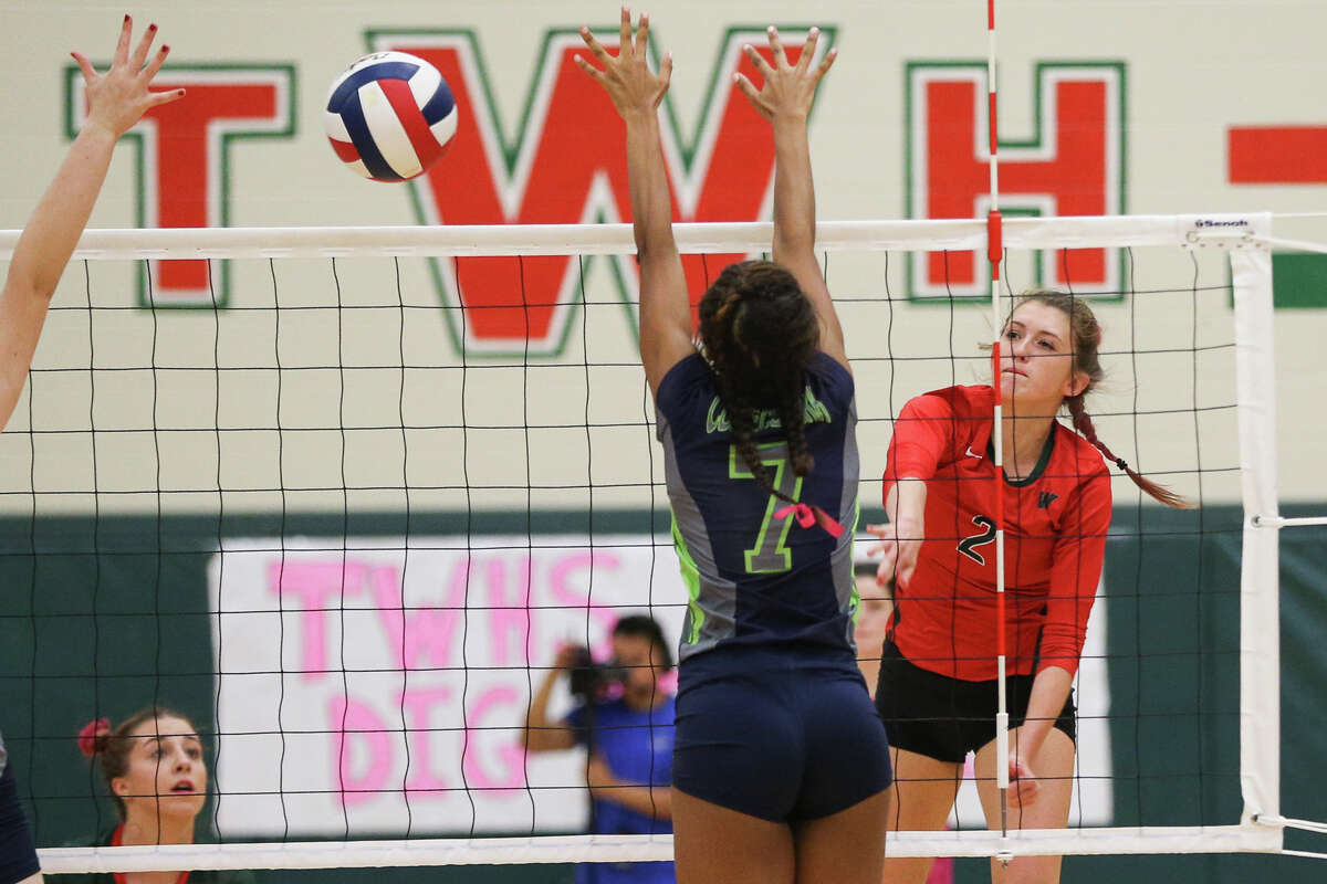 The Woodlands' (2) hits the ball during the varsity volleyball game against College Park on Tuesday, Oct. 18, 2016, at The Woodlands High School.