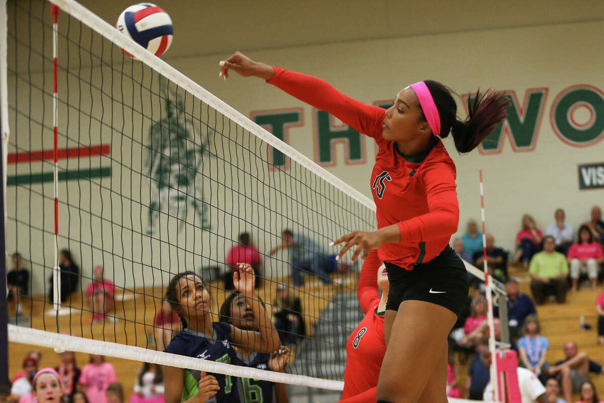 Oct. 18: The Woodlands def. College Park 18-25, 25-18, 25-19, 25-21 The Woodlands' Sydney Jackson (15) hits the ball during the varsity volleyball game against College Park on Tuesday, Oct. 18, 2016, at The Woodlands High School.