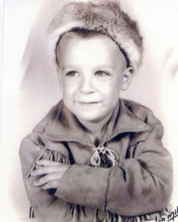 Robert Duncan Wark, also known as Bob, poses for the camera in his wonderful Daniel Boone costume.  Like all boys his age, he loved the Fess Parker television series about Daniel Boone.