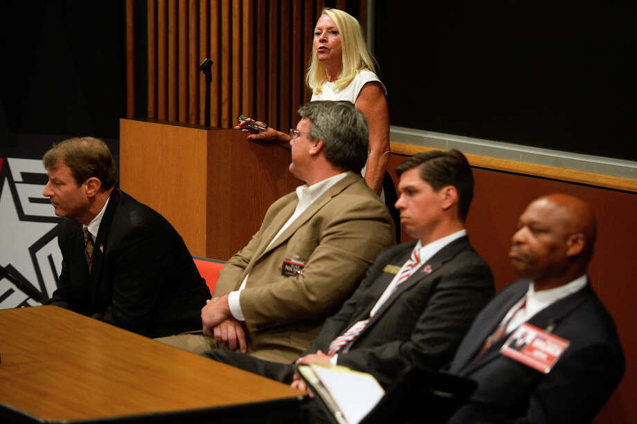 Terri B. Davis, chair of Lamar University's political science department, asks a question during a forum for judicial candidates at the university on Tuesday evening. The candidates, from left, are Dana Timaeus, Luke Nichols, Baylor Wortham and Terrence Holmes.  Photo taken Tuesday 10/18/16 Ryan Pelham/The Enterprise Photo: Ryan Pelham / ©2016 The Beaumont Enterprise/Ryan Pelham