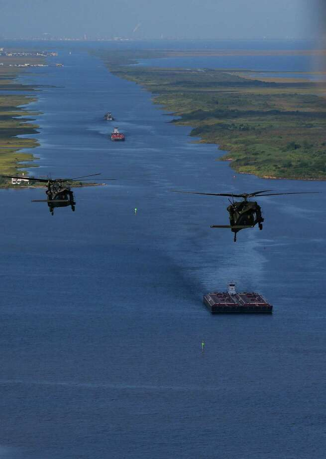 "Army Black Hawk helicopters, carrying U.S. Army Corps of Engineers officials, flies over the Bolivar Peninsula Wednesday, September 7, 2016. A dike, called the ""Ike Dike,"" is being proposed to protect Galveston, Bolivar and the Galveston Bay area from storm surges.  ( Michael Ciaglo / Houston Chronicle ) Photo: Michael Ciaglo, Staff / © 2016  Houston Chronicle"