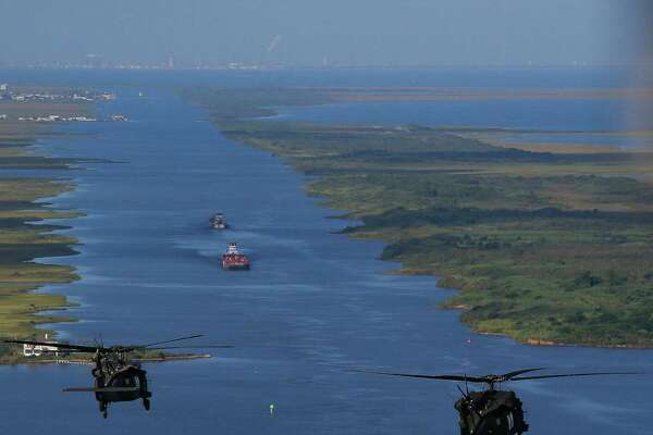 """Army Black Hawk helicopters, carrying U.S. Army Corps of Engineers officials, flies over the Bolivar Peninsula Wednesday, September 7, 2016. A dike, called the """"Ike Dike,"""" is being proposed to protect Galveston, Bolivar and the Galveston Bay area from storm surges.  ( Michael Ciaglo / Houston Chronicle )"""