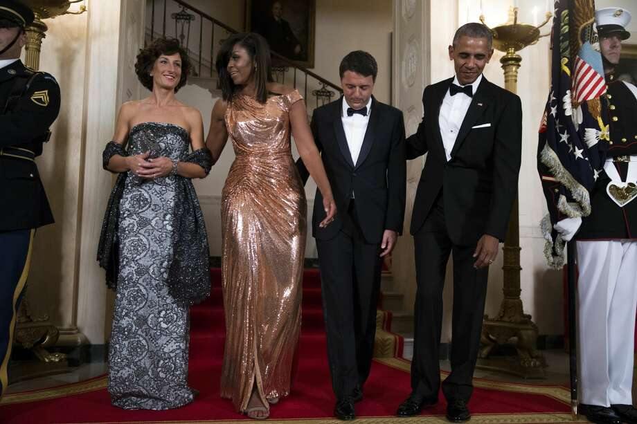 President Barack Obama (R) and First Lady Michelle Obama (2L) pose for the official picture with Italian Prime Minister Matteo Renzi (2R) and Italian First Lady Agnese Landini (L) prior to the state dinner at the White House on October 18, 2016 in Washington DC. President Obama and First Lady Michelle Obama are hosting their final state dinner featuring celebrity chef Mario Batali and singer Gwen Stefani performing after dinner.   Photo: Pool/Getty Images