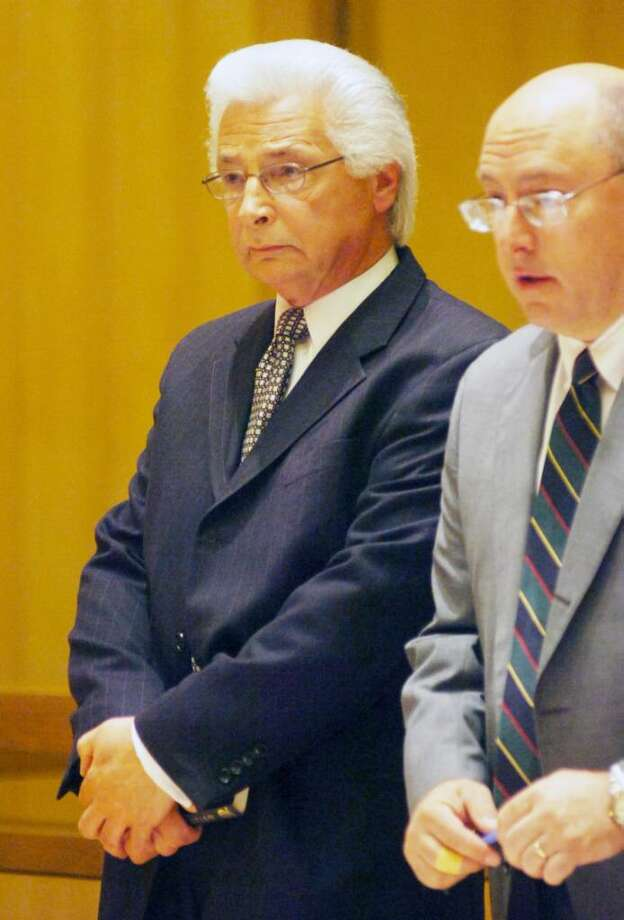 Fred Manfredonia, left, the former City of Stamford human resources employee accused of embelezment appears in Superior Court in Stamford Thursday morning with his attorney Philip Russell to face larceny and forgery charges. (Pool photo/The Hour) Photo: Contributed Photo / Stamford Advocate Contributed