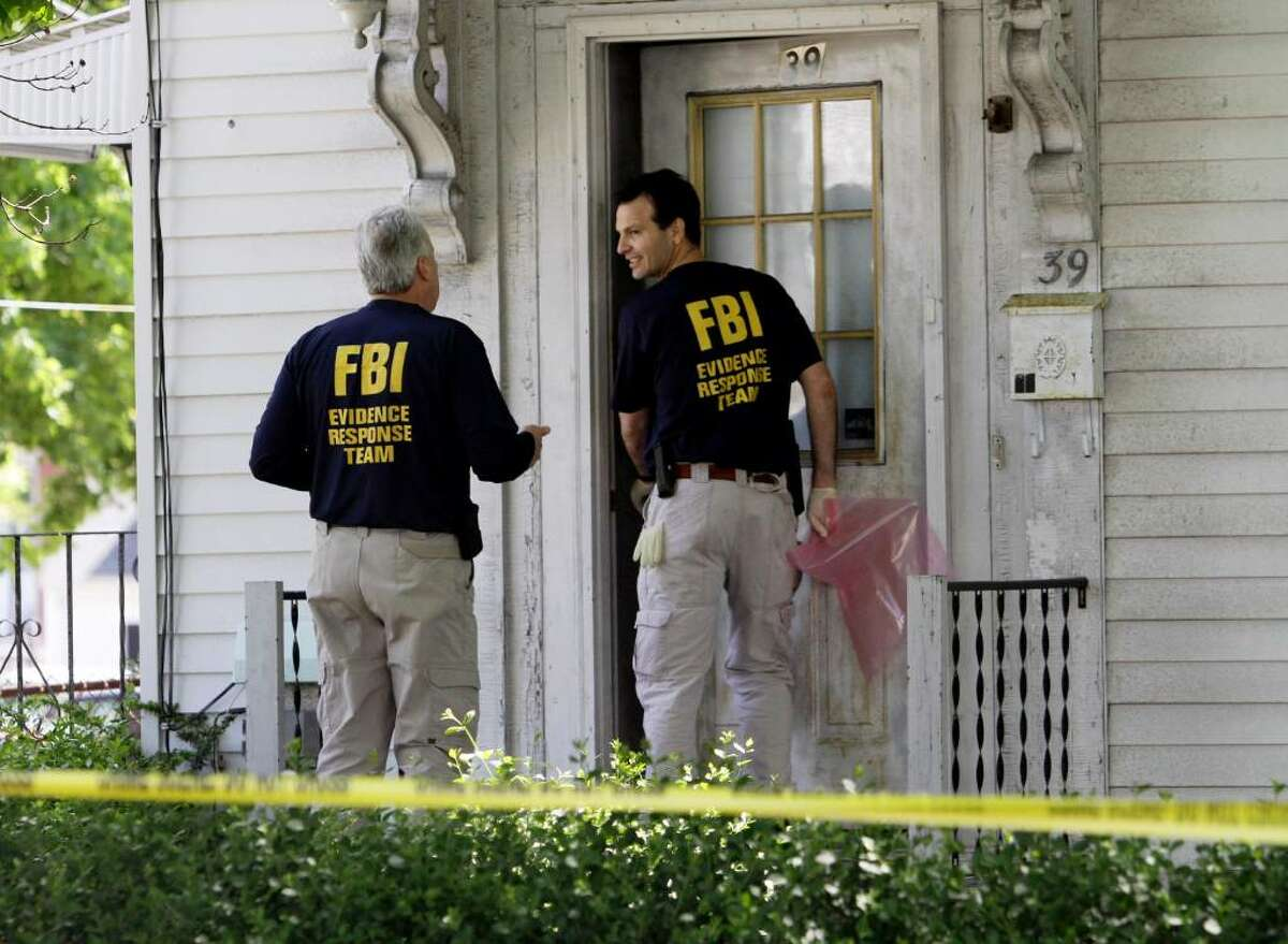 FBI investigators enter a home at 39 Waverley Avenue, in Watertown, Mass., Thursday, May 13, 2010. Federal agents arrested two people and are searching locations in Massachusetts and New York on Thursday in connection with the failed Times Square car bomb, federal authorities said. (AP Photo/Steven Senne)