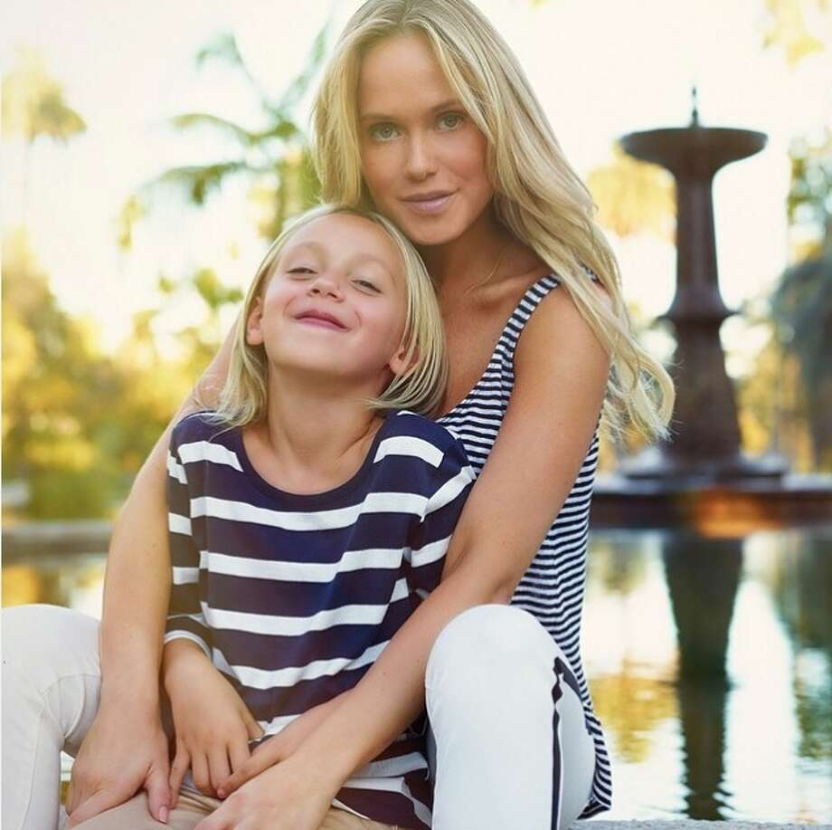"Playboy model Katie May, 34, seen here with her daughter, died Feb 4, 2016 due to injuries she sustained from a ""neck manipulation"" by her chiropractor. Her death was ruled an accident. Her family has since set up a crowdfunding page for her 7-year-old daughter Mia. Photo: Courtesy/YouCaring"