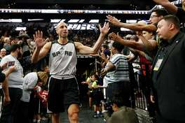 Manu Ginobili (20) greets fans at the Spurs' Silver and Black open scrimmage at the AT&T Center on Tuesday, Oct. 18, 2016.