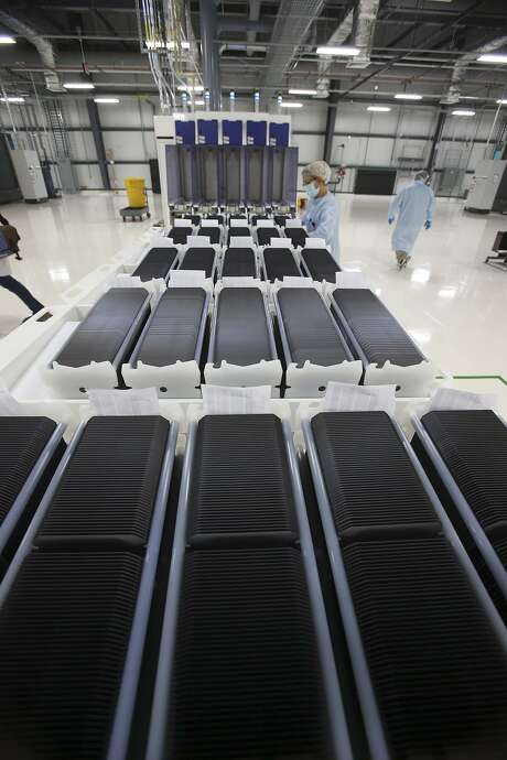 Solar wafers are stacked during the production of solar modules at Mission Solar's manufacturing plant in San Antonio. The company has announced another round of layoffs, just months after a round of 87 layoffs in October. Photo: San Antonio Express-News /File Photo / San Antonio Express-News