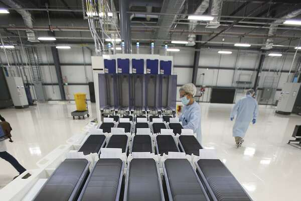 Individual wafers are stored midway in production at Mission Solar Energy in this 2014 photo. Mission Solar is ending its solar cell production and laying off 87 workers.