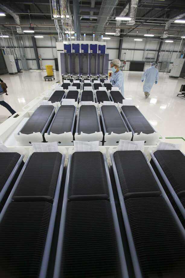 Individual wafers are stored midway in production at Mission Solar Energy in this 2014 photo. Mission Solar is ending its solar cell production and laying off 87 workers. Photo: San Antonio Express-News /File Photo / San Antonio Express-News
