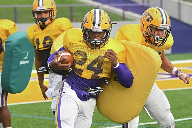 University at Albany running back Elijah Ibitokun-Hanks carries the ball during a drill at football practice on Thursday, Sept. 29, 2016 in Albany, N.Y. (Lori Van Buren / Times Union)