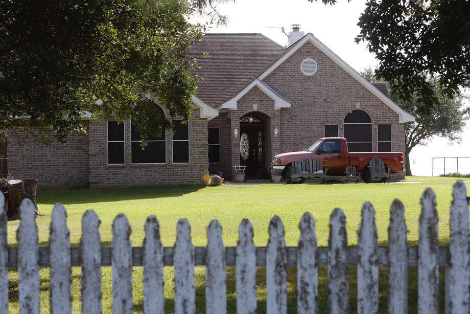 Police are seen at a home in the 11400 block of Cedar Gully Road in Beach City, Texas on Oct. 19, 2016. A man and woman in their 70s were found murdered in their bed the night before. The couple's 14-year-old grandson is a person of interest in the case. Photo: Melissa Phillip/Houston Chronicle