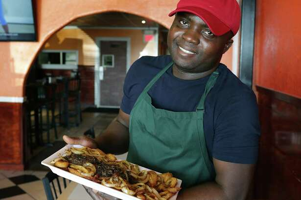 Stephen Ekwunife, owner and executive chef of Kobams African Restaurant, makes an especially good grilled whole tilapia with onions and fried plantains.