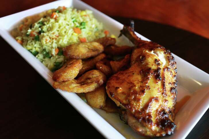 Fried rice with grilled chicken and fried plantains at Kobams African Restaurant.