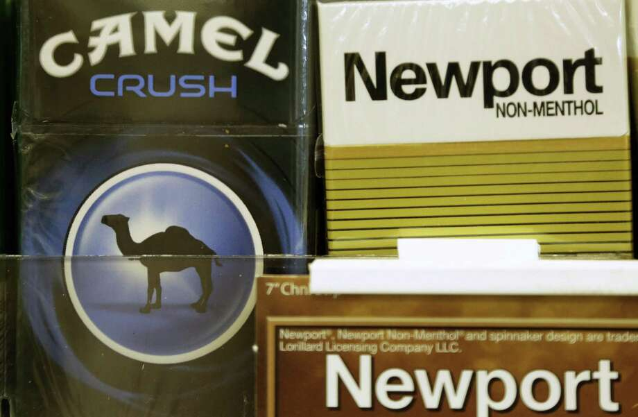 Reynolds American also reported third-quarter earnings Wednesday. Profit was 61 cents per share, excluding some items, the company in a statement. Analysts had estimated 64 cents, on average. Sales excluding excise taxes rose 1.4 percent to $3.21 billion, trailing analysts' $3.31 billion average projection. Photo: Associated Press /File Photo / AP2014