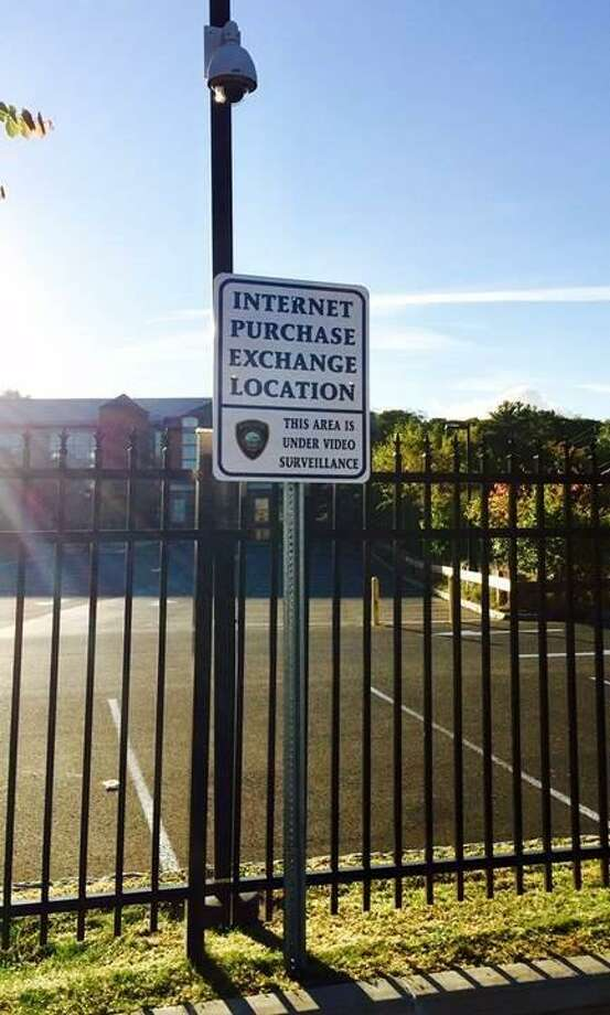 On Oct. 12, 2016, Darien police placed this sign designating the police headquarters parking lot in Darien, CT as a safe internet purchase exchange site. Photo: Contributed Photo / Contributed Photo / Darien News