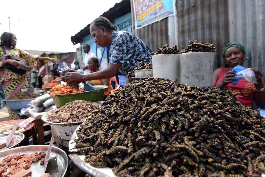 FILE - This photo taken on July 9, 2014 shows caterpillars on sale at Kinshasa's Gambela market. Photo: JUNIOR D. KANNAH/AFP/Getty Images