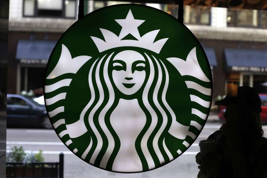 "Chinese customers spend more time in Starbucks shops and are buying more food than Americans, Starbucks CEO Howard Schultz told the Associated Press. Late next year, Starbucks plans to open a 30,000-square-foot store in Shanghai that Schultz called a ""Disneyland for coffee."" Photo: Associated Press /File Photo / Copyright 2016 The Associated Press. All rights reserved."