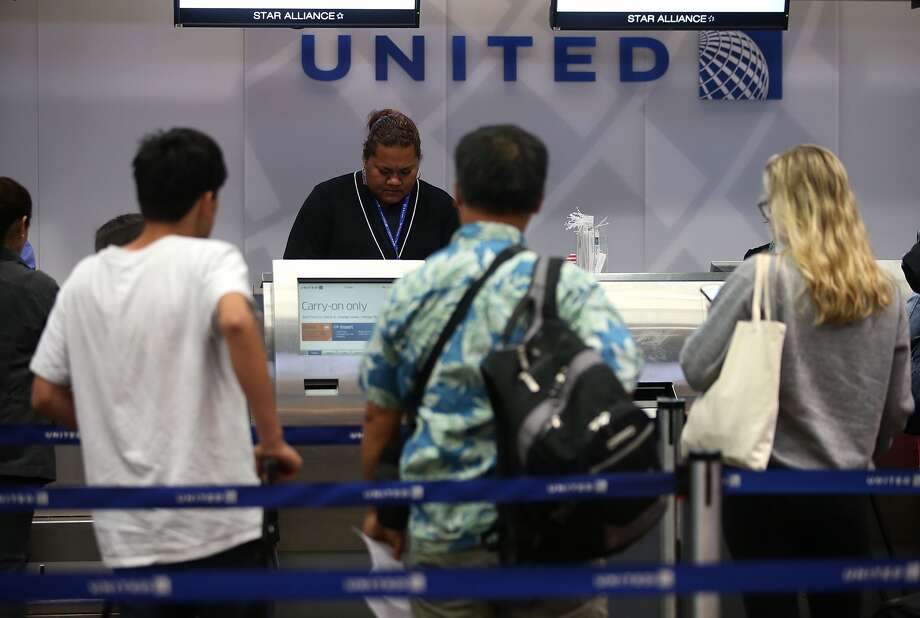 SAN FRANCISCO, CA - JULY 08: United Airlines passengers check in for flights at San Francisco International Airport on July 8, 2015 in San Francisco, California. Thousands of United Airlines passengers around the world were grounded Wednesday due to a computer glitch. An estimated 3,500 were affected. (Photo by Justin Sullivan/Getty Images)