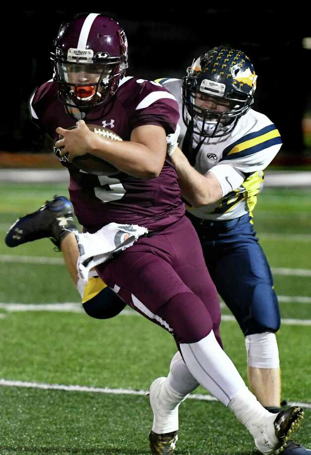 Lansingburgh's Mike Zanda, left, carries the ball as Averill Park's Dennon Fisher defends during their football game on Friday, Oct. 14, 2016, at Lansingburgh High in Troy, N.Y. (Cindy Schultz / Times Union) Photo: Cindy Schultz / Albany Times Union