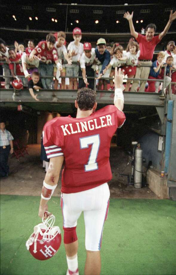 11/03/1990 - TCU Horned Frogs v Houston Cougars. Cougars quarterback David Klingler acknowledges the crowd after his seven touchdown passes and Chuck Weatherspoon's relentless running carried the undefeated Cougars to a 56-35 victory over the Horned Frogs before 25,725 at the Astrodome. Klingler completed 36 of 53 passes for 563 yards with four interceptions. Photo: Gaylon Wampler, Houston Chronicle / Houston Post files