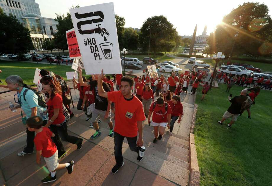 A line of protesters against the construction of the Dakota Access oil pipeline on the Standing Rock Reservation in North Dakota head to a unity rally on the west steps of the State Capitol late Thursday, Sept. 8, 2016, in Denver. Several hundred marchers walked from the four directions to the Capitol to take part in the rally against the oil pipeline. (AP Photo/David Zalubowski) Photo: David Zalubowski, STF / Copyright 2016 The Associated Press. All rights reserved.