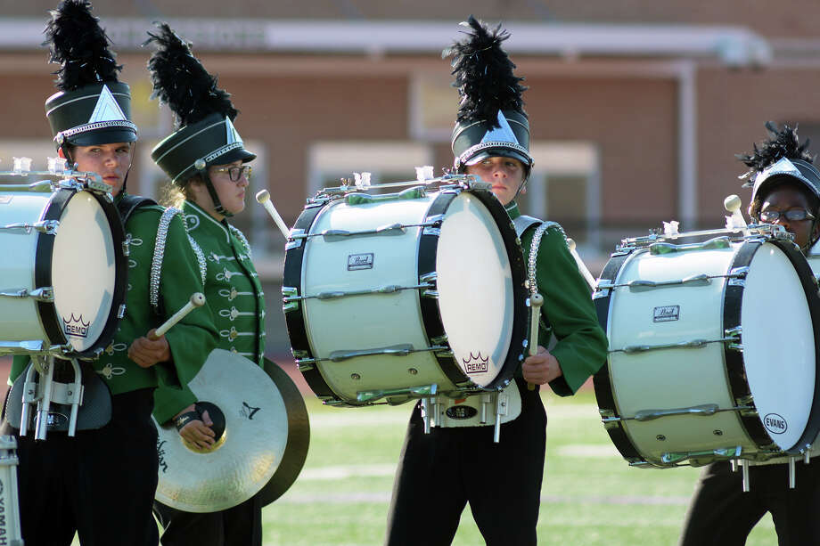 Kingwood Park High School senior snare drummer Ainsley Montgomery, from left, junior cymbalist Megan Tartamella, freshman bass drummer Colin Hanebuth, and sophomore bass drummer Jalen Williams join their fellow Panther Marching Band members in their performance during the 2016 Humble ISD Marching Band Festival at Turner Stadium in Humble on Oct. 15, 2016. (Photo by Jerry Baker/Freelance) Photo: Jerry Baker, Freelance / Freelance