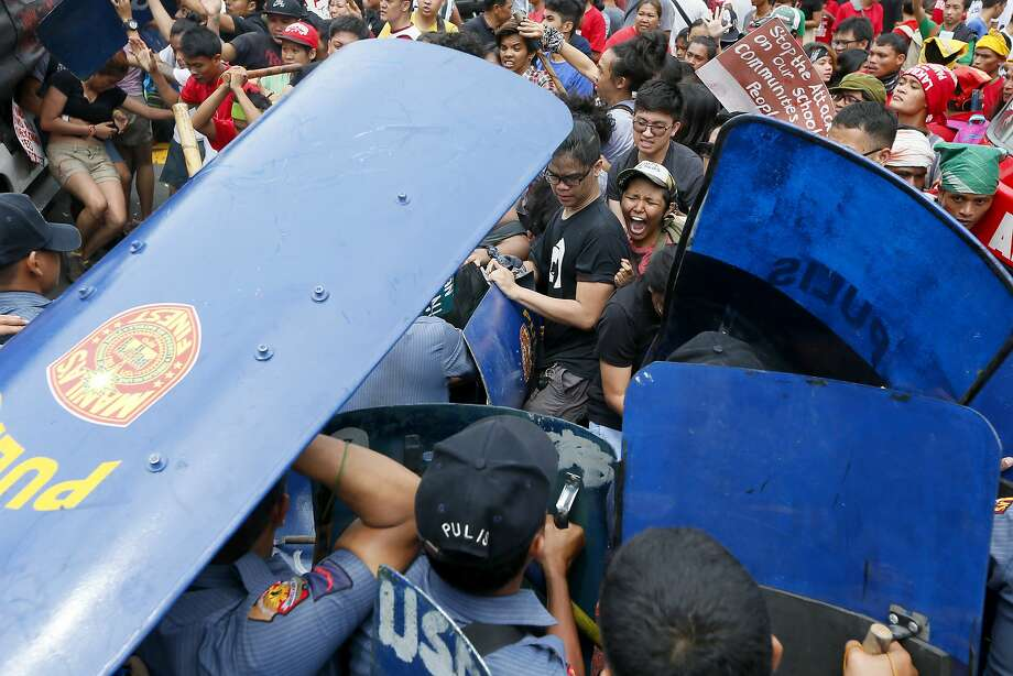 Police and demonstrators clash during a violent protest outside the U.S. Embassy in Manila. Photo: Bullit Marquez, Associated Press