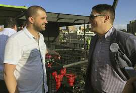 In this Sept. 22, 2016 photo, Denver marijuana consultant Kayvan Khalatbhari, left, chats with a lobbyist Joe Megysy at a fundraiser for marijuana policy reform in Denver. Business owners are replacing idealists in the pot-legalization movement as the nascent marijuana industry creates a donor base of entrepreneurs willing to spend to change drug policy. (AP Photo/Kristen Wyatt)