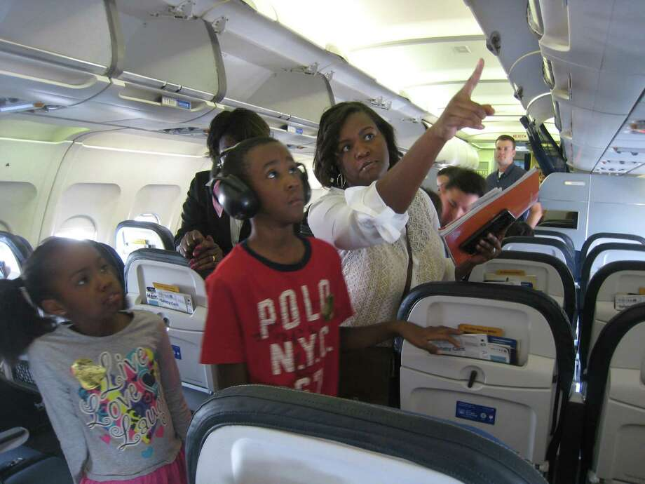 To ease fears and make trips to the airport more routine, children with intellectual and developmental disabilities and their families went on a mock flight Oct. 18 at Bush Intercontinental Airport. Photo: Jennifer Summer