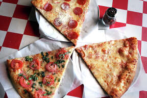 Slice of Cheese, right, Pepperoni, top, and Margherita Pizza, left, from Julian's Italian Pizzeria and Kitchen, Thursday, Jan. 21, 2010. BOB OWEN/rowen@express-news.net