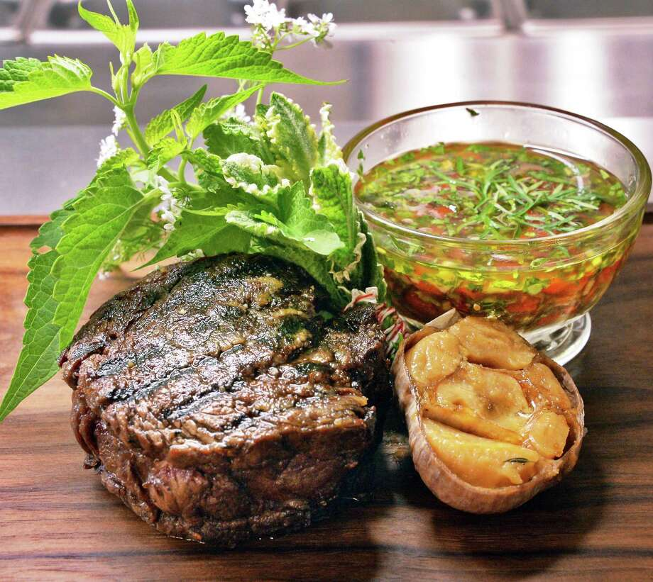 A ribeye cap or spinalis dorsi with chimichurri sauce and roasted garlic at Salt & Char restaurant Thursday June 23, 2016 in Saratoga Springs, NY.  (John Carl D'Annibale / Times Union) Photo: John Carl D'Annibale / 40037101A