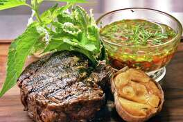 A ribeye cap or spinalis dorsi with chimichurri sauce and roasted garlic at Salt & Char restaurant Thursday June 23, 2016 in Saratoga Springs, NY.  (John Carl D'Annibale / Times Union)