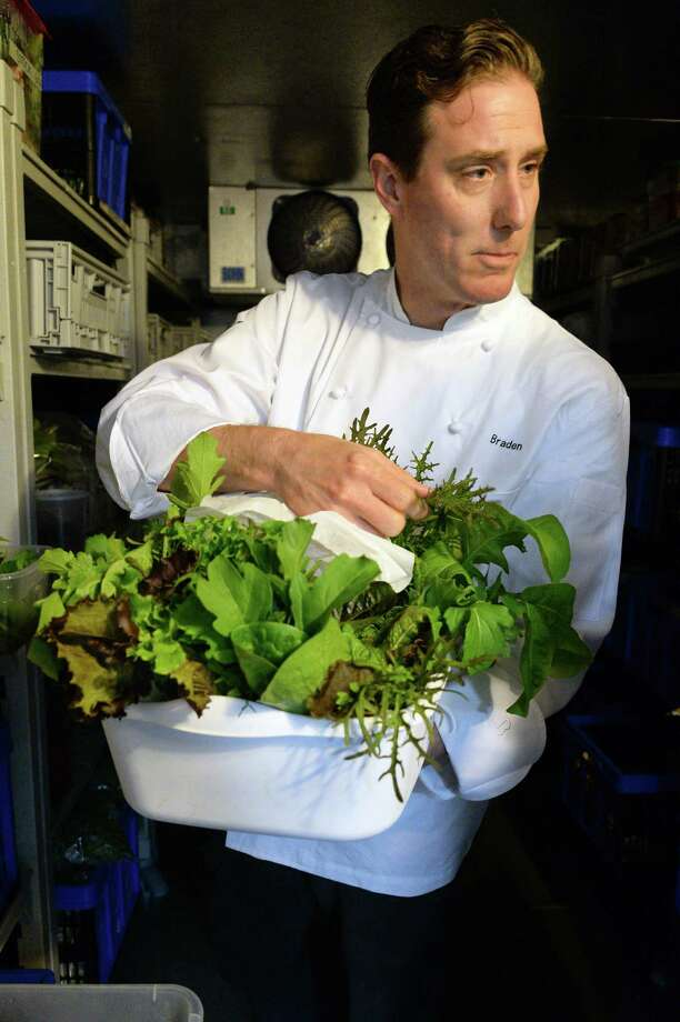 Executive chef Braden Reardon with assorted greens from Little Fields Farm in Argyle in the walk-in cooler at the Salt & Char restaurant at the Van Dam hotel Thursday June 23, 2016 in Saratoga Springs, NY.  (John Carl D'Annibale / Times Union) Photo: John Carl D'Annibale / 40037101A