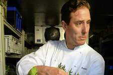 Executive chef Braden Reardon with assorted greens from Little Fields Farm in Argyle in the walk-in cooler at the Salt & Char restaurant at the Van Dam hotel Thursday June 23, 2016 in Saratoga Springs, NY.  (John Carl D'Annibale / Times Union)