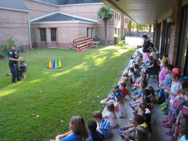 Harris County Sheriff's Deputy Steve Shaddox and his K-9 partner Mack demonstrated basic commands and training to the delight of students at the Good Shepherd Episcopal School in Kingwood.