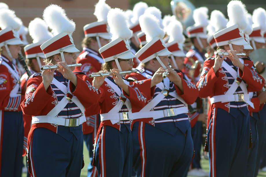 Atascocita High School flutists Sydney Knipe, left, Alondra Martinez, Victoria Missildine  and Rachel Cannon and their Eagle Marching Band members perform during the 2016 Humble ISD Marching Band Festival at Turner Stadium in Humble on Oct. 15. Photo: Jerry Baker, Freelance / Freelance