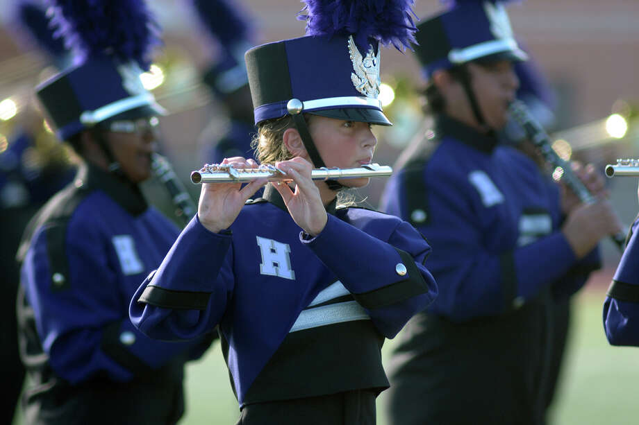 Humble High School freshman flutist Megan Hillyer, 14, center, and her fellow Wildcat Marching Band members perform during the 2016 Humble ISD Marching Band Festival at Turner Stadium in Humble on Oct. 15. Photo: Jerry Baker, Freelance / Freelance