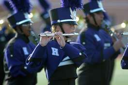 Humble High School freshman flutist Megan Hillyer, 14, center, and her fellow Wildcat Marching Band members perform during the 2016 Humble ISD Marching Band Festival at Turner Stadium in Humble on Oct. 15.