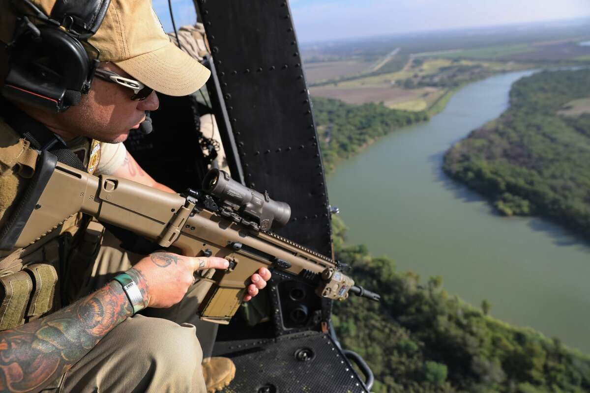 A Customs and Border Protection agent scans the Rio Grande on the U.S.-Mexico border on October 18, 2016 in McAllen, Texas. U.S. Air and Marine Operations agents fly over border areas, coordinating with Border Patrol agents on the ground to stop undocumented immigrants and drug smugglers from entering the U.S. Immigration and border security have become major issues in the American Presidential campaign. (Photo by John Moore/Getty Images)