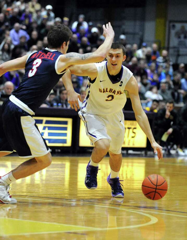 UAlbany's Joe Cremo brings the ball up court  during their America East college men's basketball game against Stony Brook at the SEFCU Arena on Wednesday Feb. 17, 2016 in Albany, N.Y.  (Michael P. Farrell/Times Union) Photo: Michael P. Farrell / 10035424A