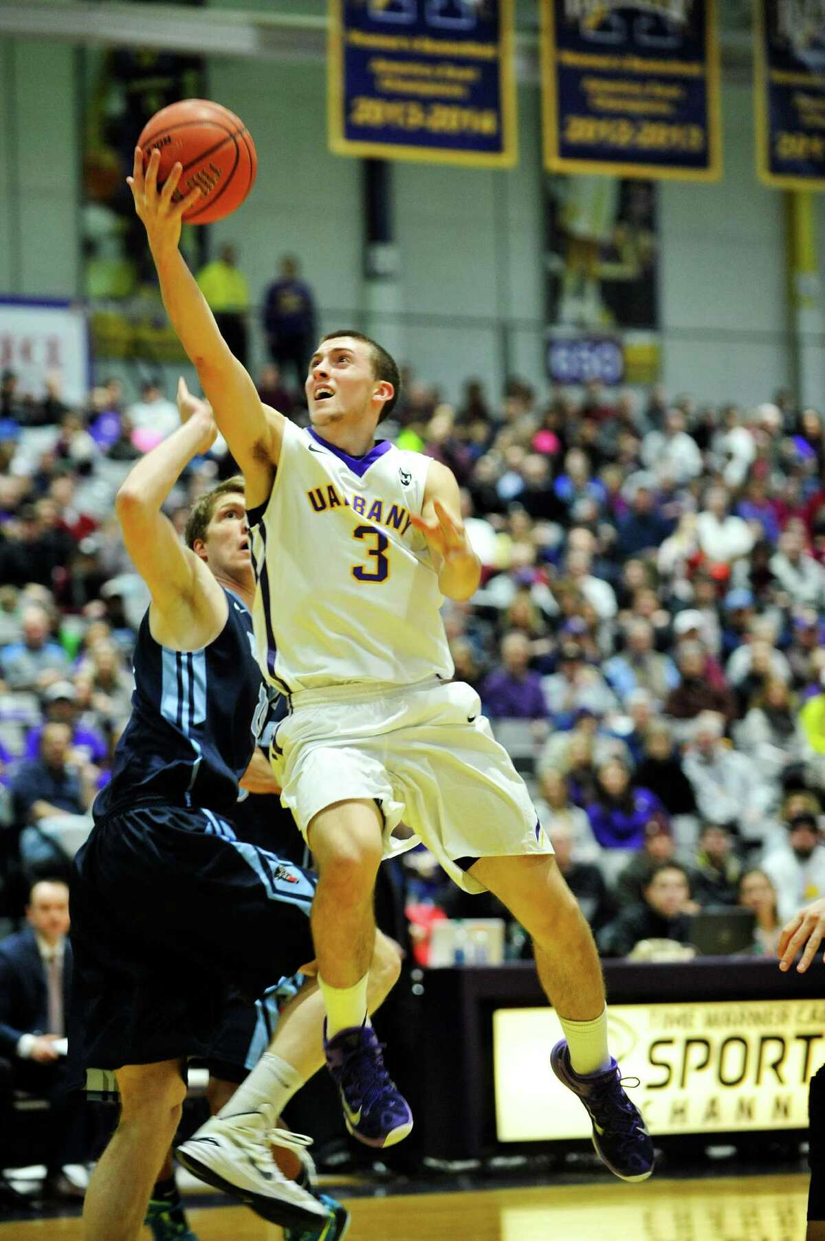 Joe Cremo of the UAlbany puts up a shot over a Maine player during their game on Sunday, Feb. 14, 2016, in Albany, N.Y. (Paul Buckowski / Times Union)