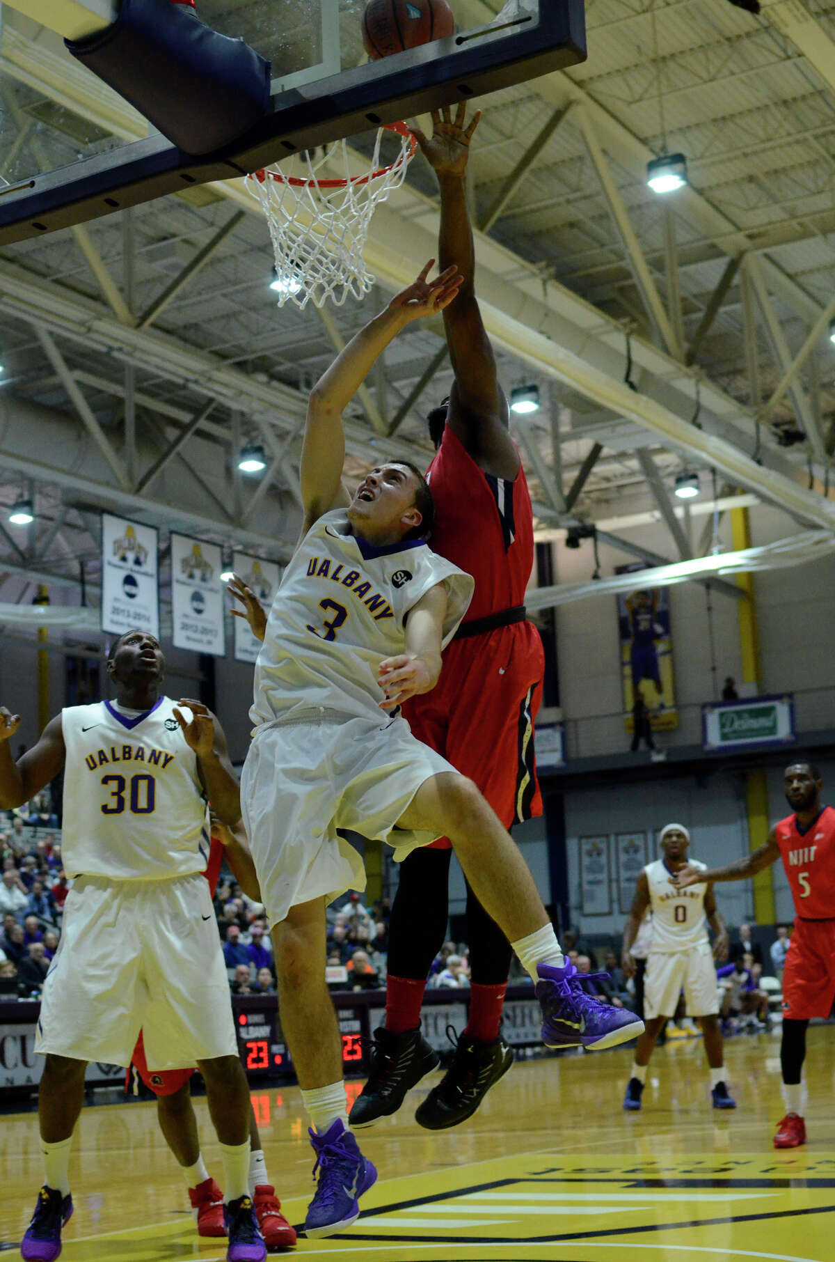 UAlbany guard Joe Cremo's shot is blocked by New Jersey Institute of Technology forward Tim Coleman during the Naismith Basketball Hall of Fame Classic, Friday, Nov. 27, 2015, at University at Albany in Albany, N.Y. (Jenn March/Special to the Times Union)